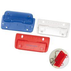 plastikowe dziurkacze do papieru w kolorach niebieskim, czerwonym i białym